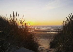 De Haan Sonnenaufgang am Meer